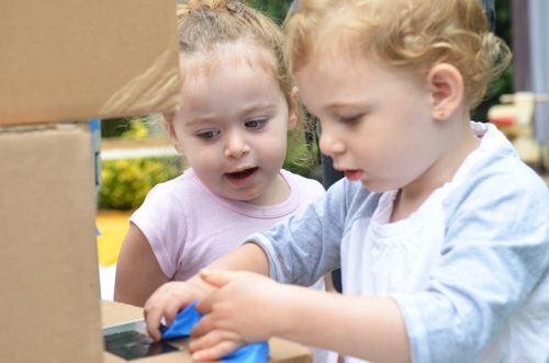 Making a cardboard tower with toddlers - play group activity