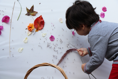 building a nature wall with toddlers - contact paper on canvas