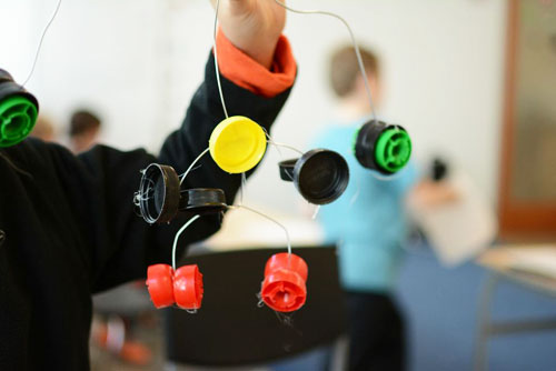 Calder Inspired Bottle Cap Mobile - Recycled Crafts for Kids