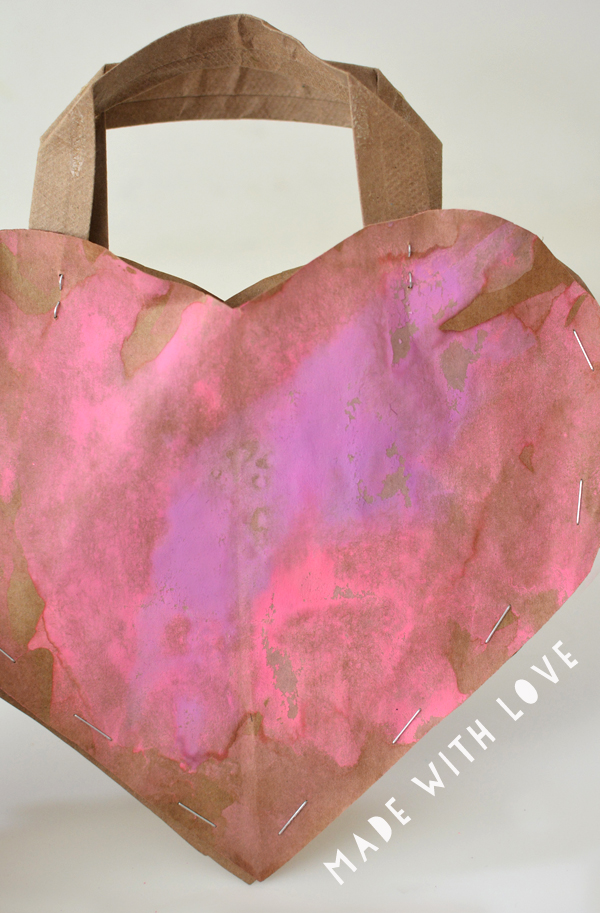 A recycled paper bag heart purse made with a lot of love