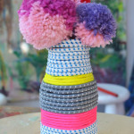 this is such a cute project for older kids to make for Mother's Day! Pom pom making is totally addicting.