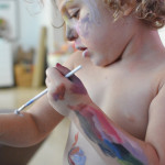Most young children love face painting. Let them enjoy the process and you won't believe how engaged and careful they will be. Then just jump in the bath after. Promise, it's way more no mess than you think!